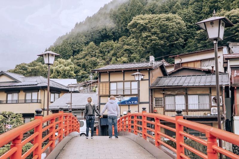 Kashlee Trevor on bright orange bridge in Gujo Japan