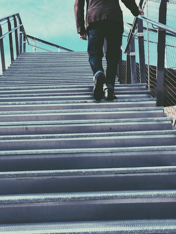 take the stairs while traveling to help stay in shape