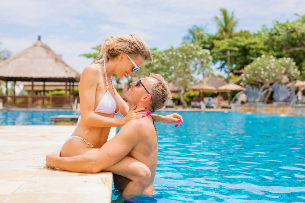 Couple on romantic holidays in resort pool