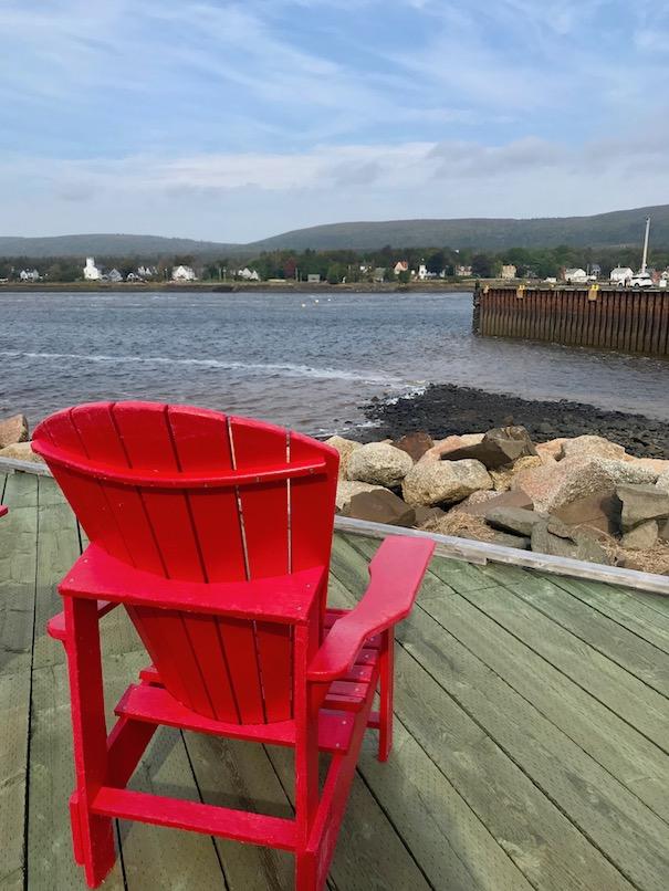 Red chair on boardwalk