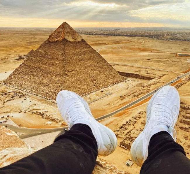 AN INSTAGRAM influencer spent five days in an Egyptian jail after climbing the ancient pyramids to take selfies. Vitaly Zdorovetskiy, 27, shared a picture on Instagram showing what appeared to his feet dangling over a pyramid with the Giza pyramid complex in the background.