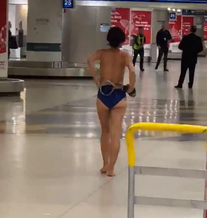 C:\Users\coach\Desktop\naked woman at airport.jpg
