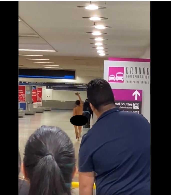 woman naked at airport