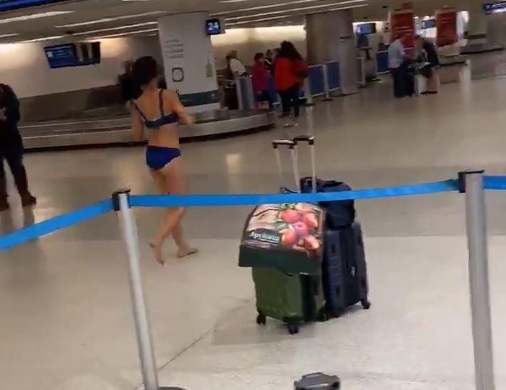 woman naked at miami airport