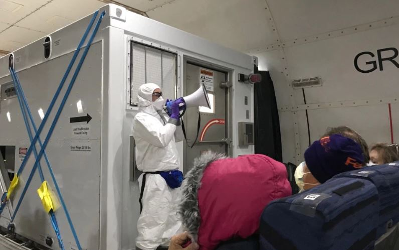14 Americans who got virus on cruise are flown home in isolation box