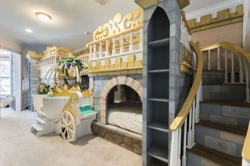 A Cinderella princess room is perfect for four kids, which includes a slide and stage
