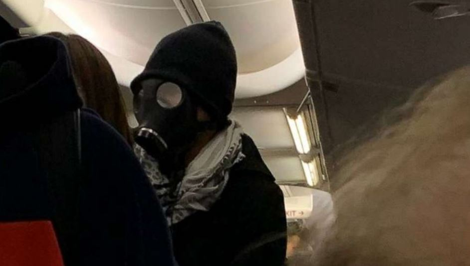 Airline Removes Man Wearing Gas Mask On Flight Causing Travelers To Panic
