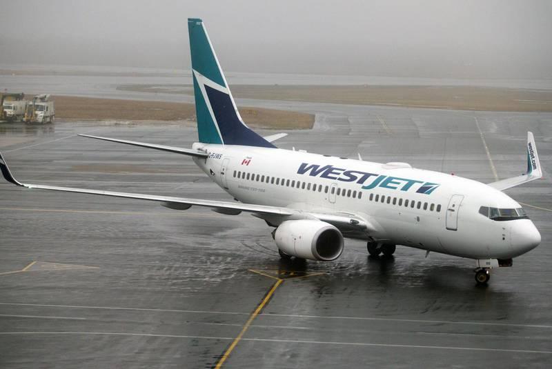 westjet flight turns around