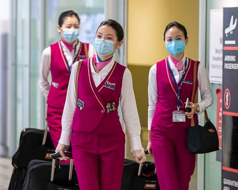 flight attendants wearing masks returning from china