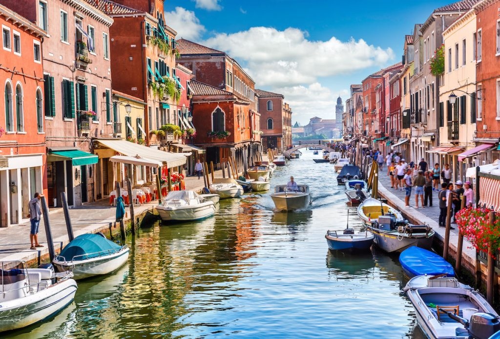 Italy canals with tourists on boats