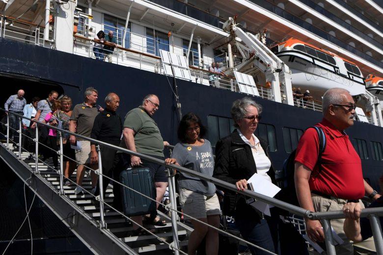 Cruise ship passengers disembark in cambodia