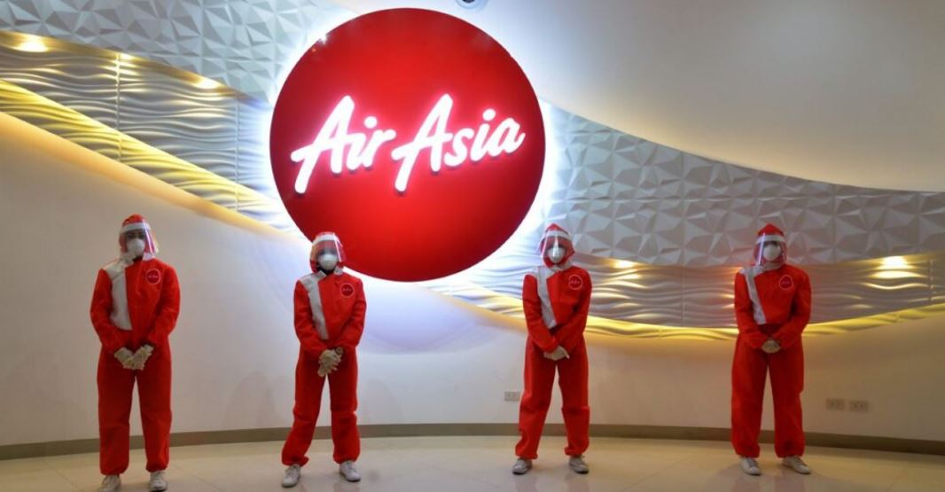 Air asia launches new flight attendant uniform with full face mask and shield