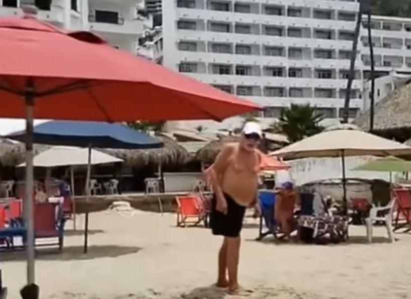 Man attacks reporter on beach