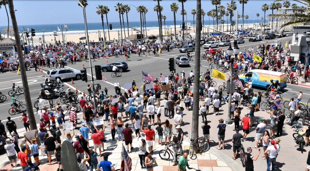 Protestors Swarm California Beach As County Records Highest Single Day Increase In Cases