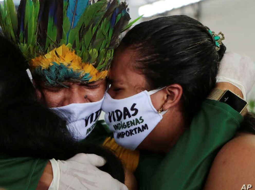 brazil natives embrace due to sadness from covid19