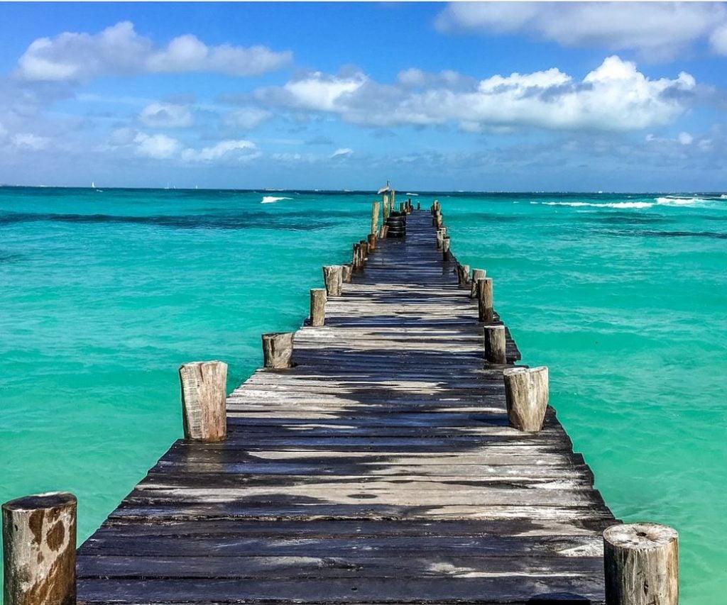 cancun boardwalk into ocean