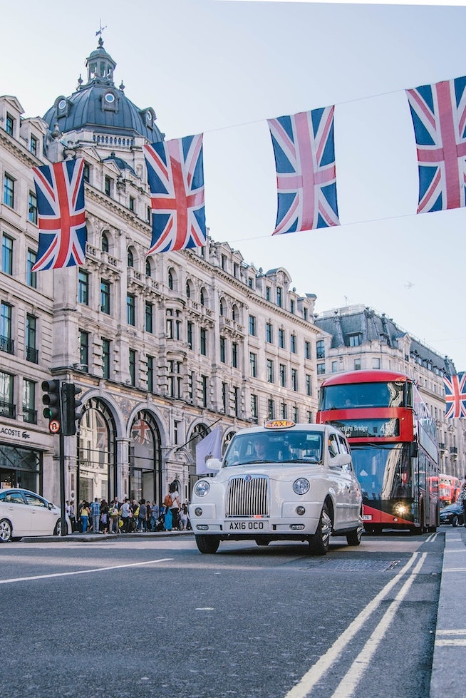 Busy united kingdom street with UK flags
