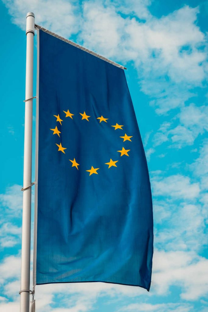 Europen Union flag with blue sky behind