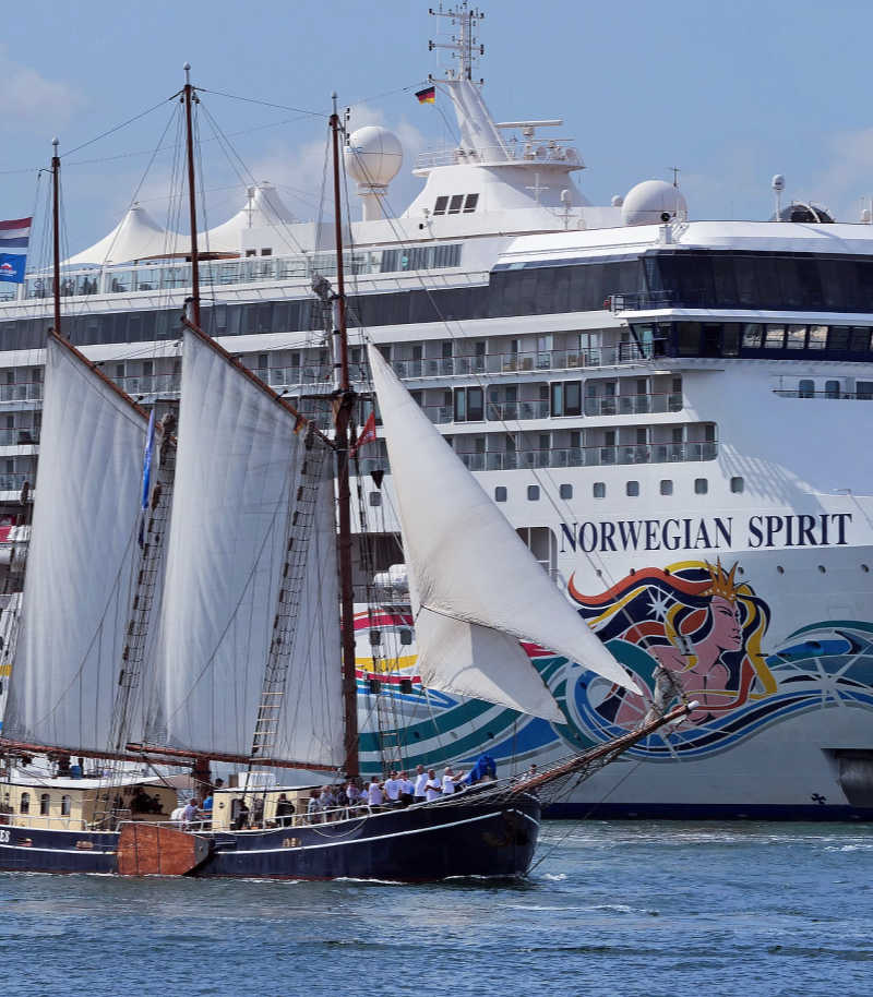 Norwegian Spirit cruise ship with old sailing ship in front