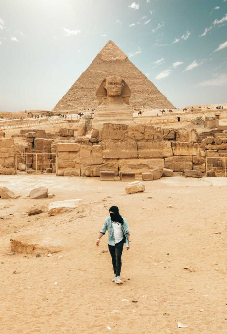 Tourist in front of pyramid in egypt