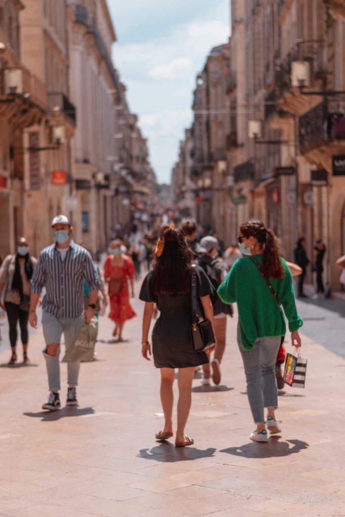 Tourists wearing masks walking street in france