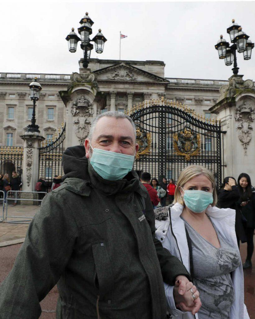 Tourists wearing masks