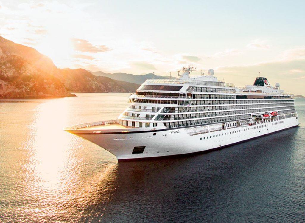 Viking Cruise ship sailing at sunset