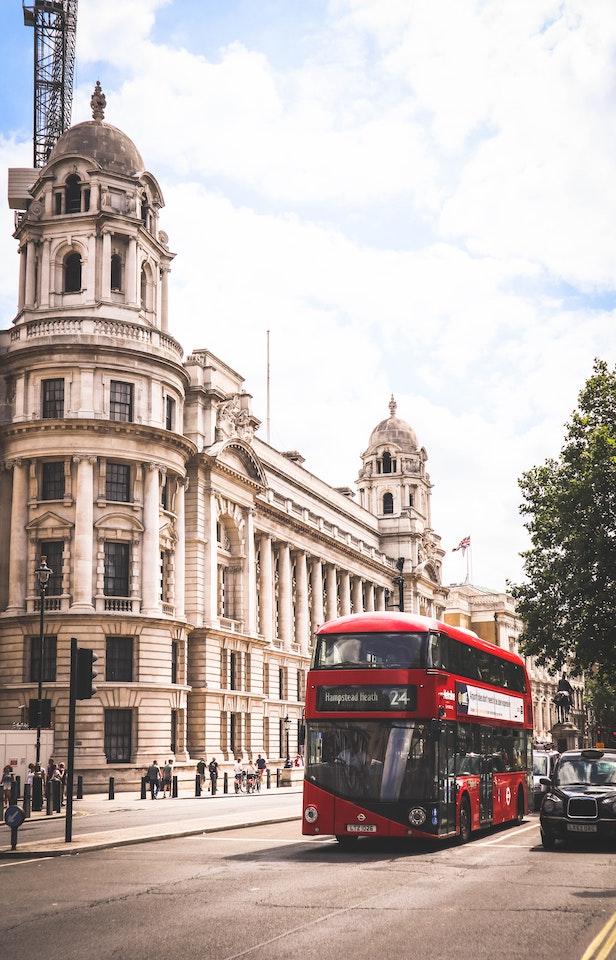 bus in london uk beside historic buildings