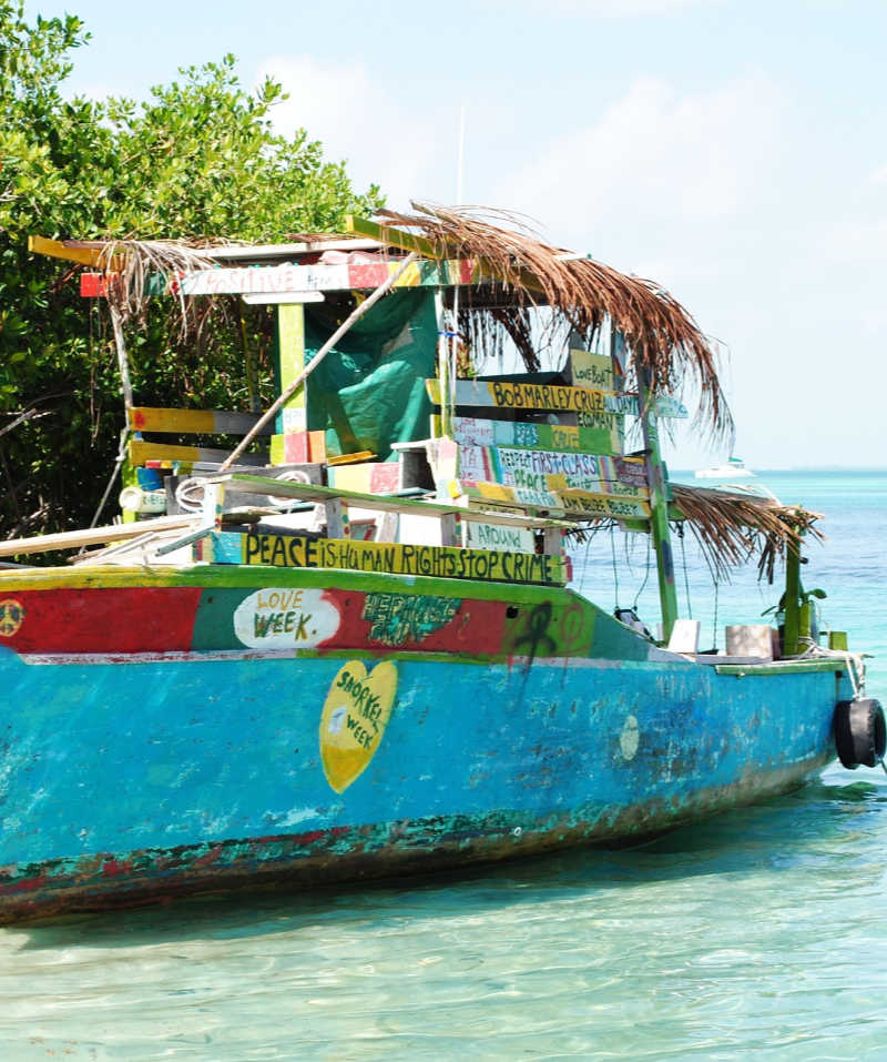 old boat on belize beach