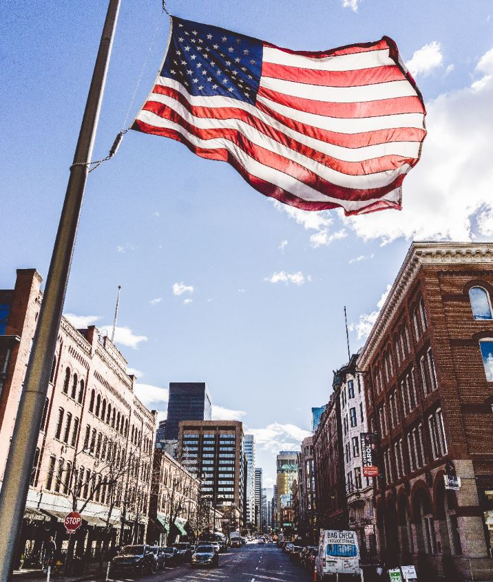 us flag over street in the united states
