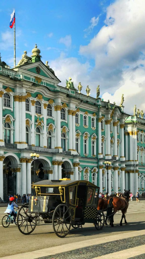 BUilding in russia with horse carriage in front