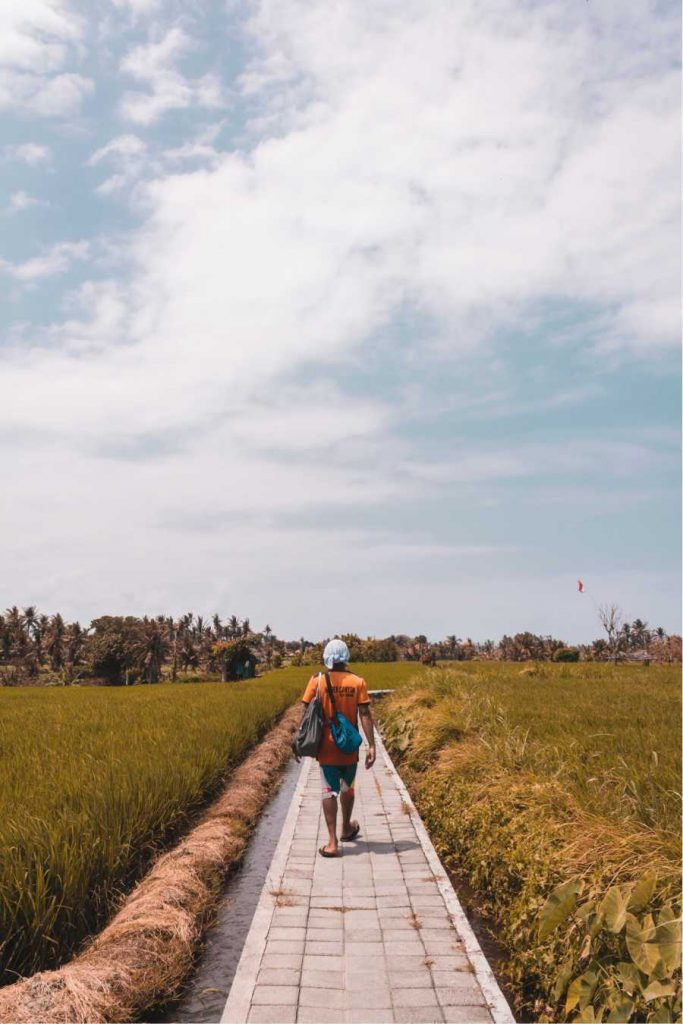 tourist-walking-on-path-in-bali