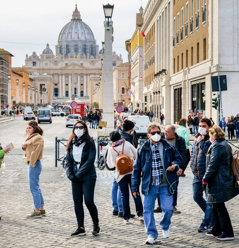A group of tourists with face masks near the St. Peter's Square, Rome, Italy