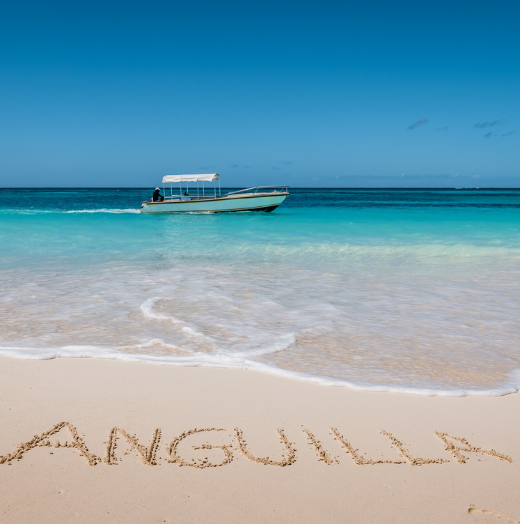 Anguilla written in sand on beach