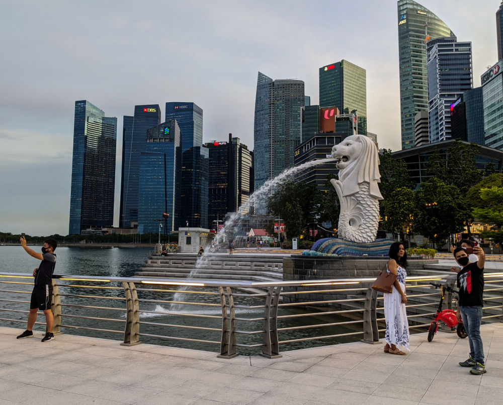 Tourists taking photos at Merlion Park in Singapore during the COVID-19 Pandemic
