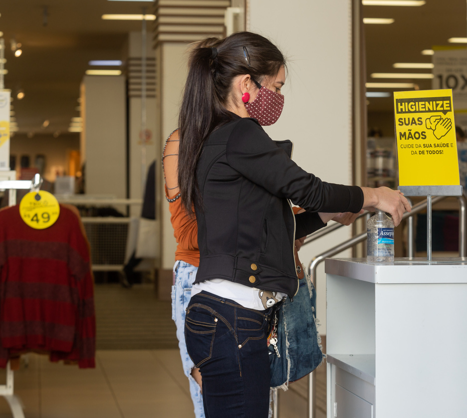Woman uses hand sanitizer while shopping in Rio de Janeiro