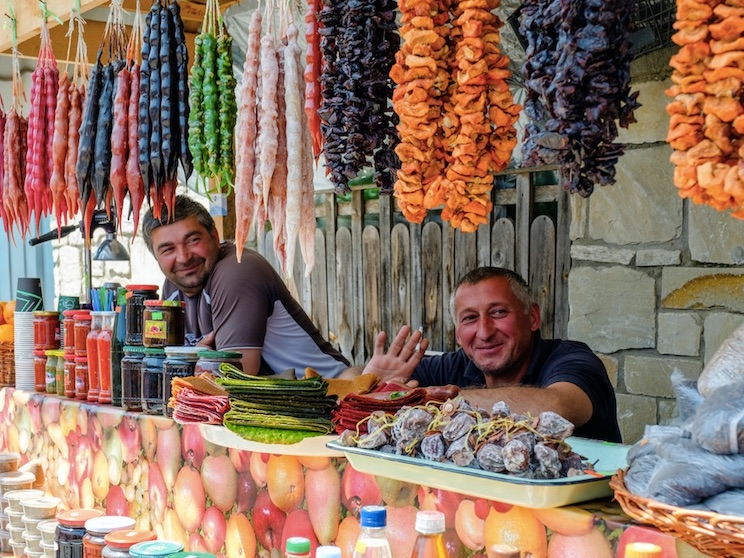 Georgian man working in small street food stall at the square in Mtskheta