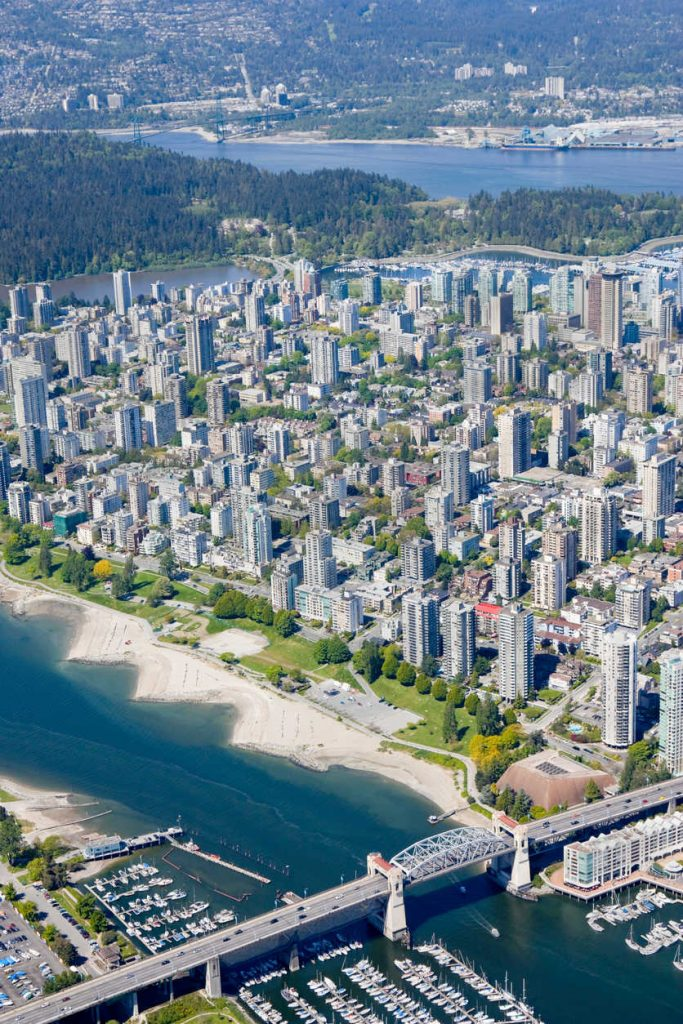 Aerial photo of downtown Vancouver, the Burrard Street Bridge and Stanley Park in the distance.