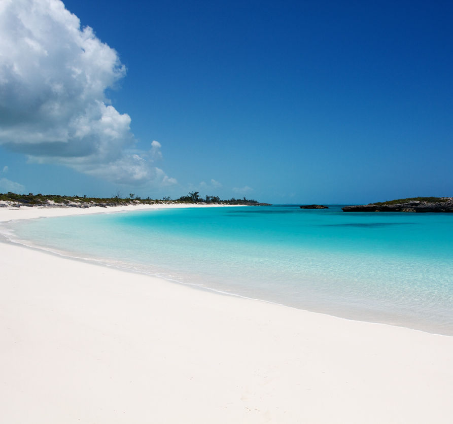Secluded white sand beach with incredible turquoise clear water, Exuma island, Bahamas