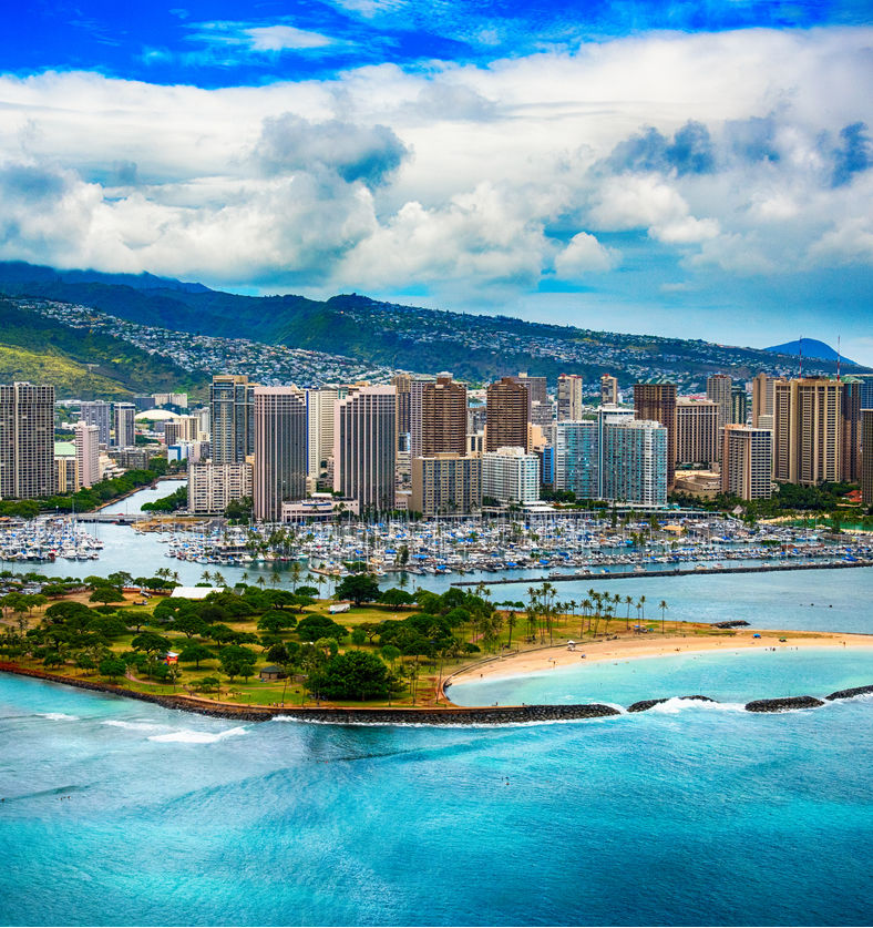 The beautiful coastline Honolulu Hawaii shot from an altitude of about 500 feet during a helicopter photo flight over the Pacific Ocean. (1)