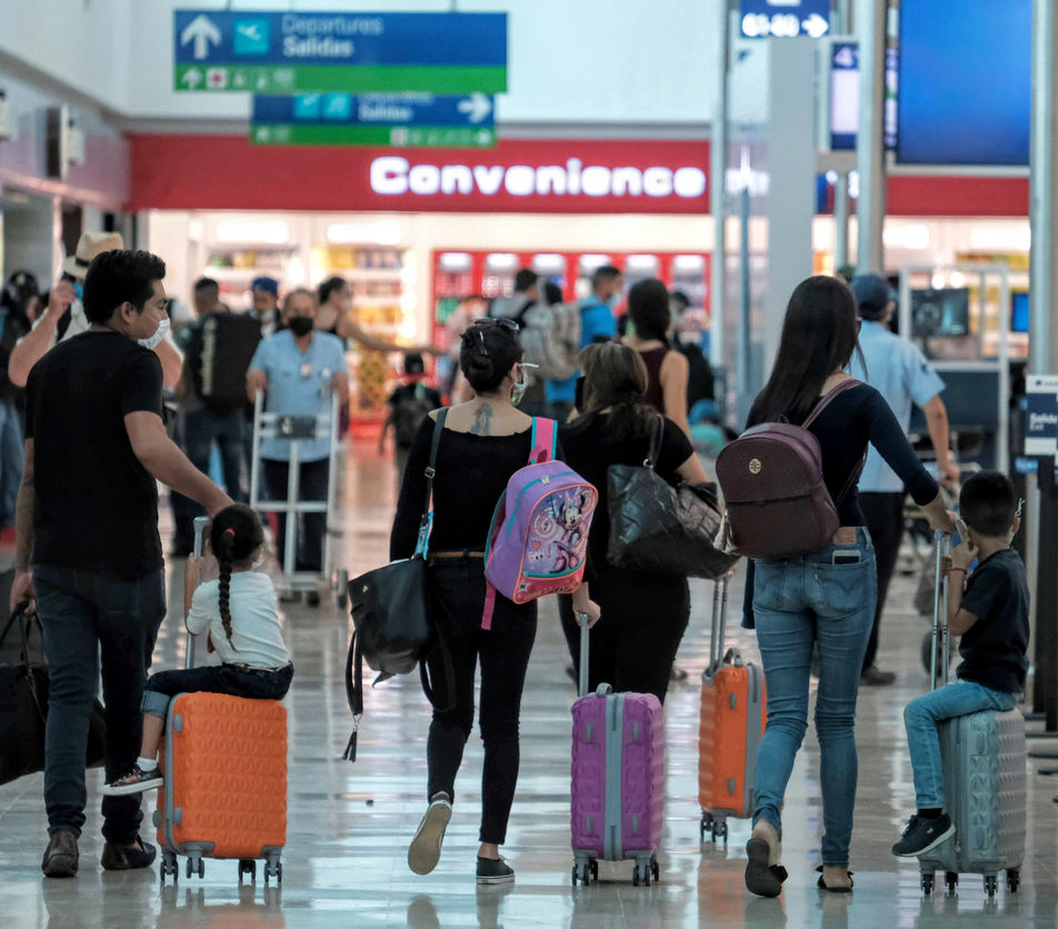 Tourists Arriving at the Cancun International Airport with face masks during COVID-19