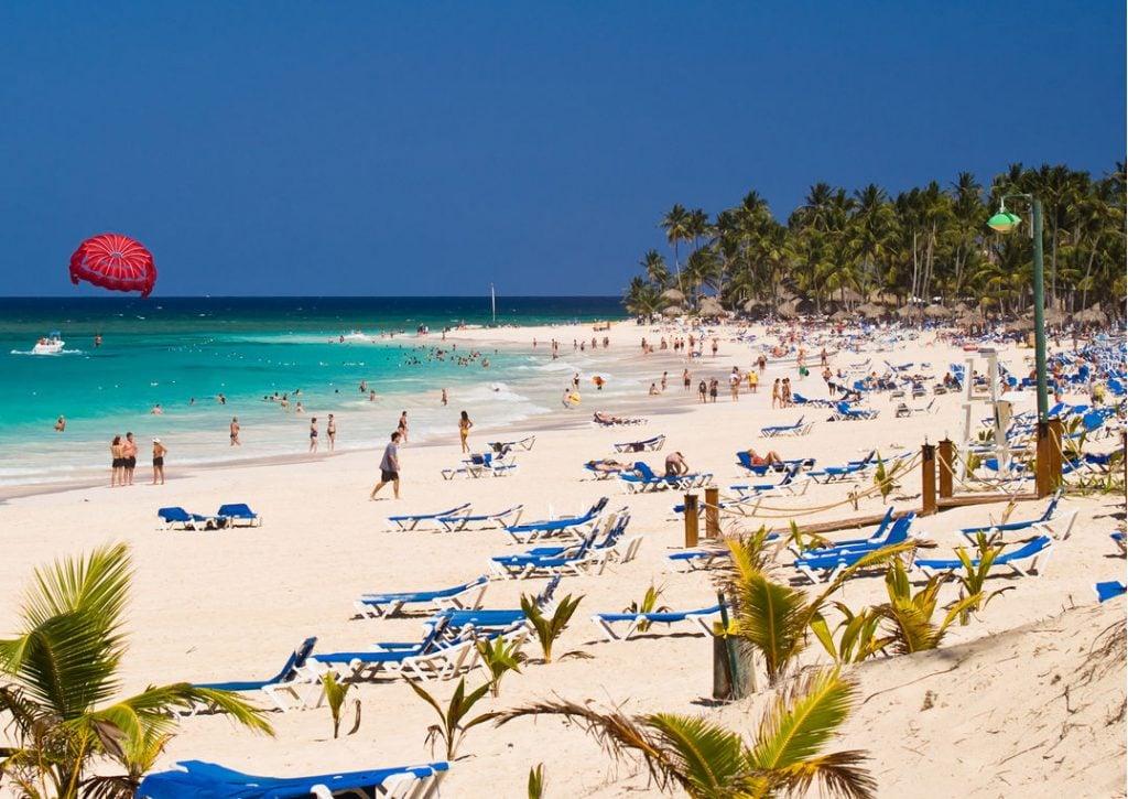 Tourists Enjoying the Beach in a Popular Resort area of Punta Cana. Bavaro Beach is on the East Coast