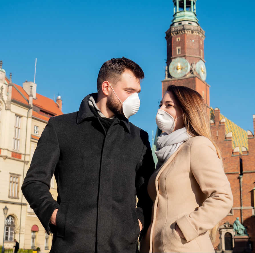Travelers wearing masks in the old town of Wroclaw, Poland