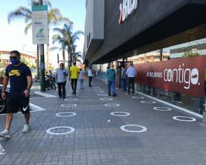 Social distancing markers on the sidewalk in Lima, Peru