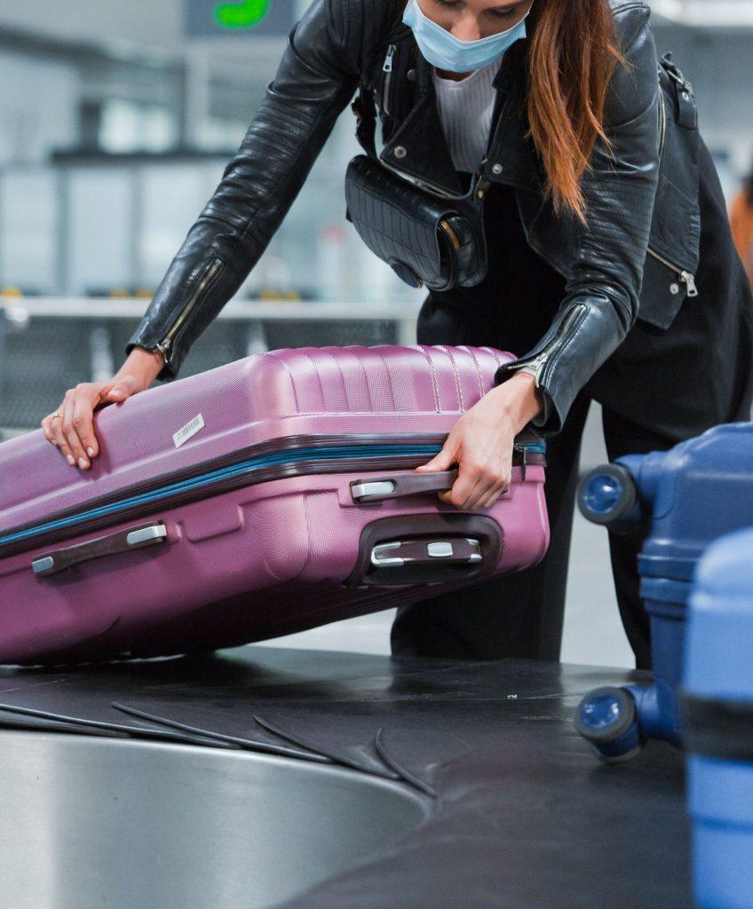 American traveler picks up bag at airport