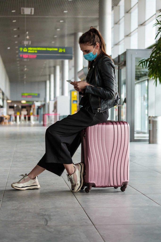 American traveler at airport wearing mask