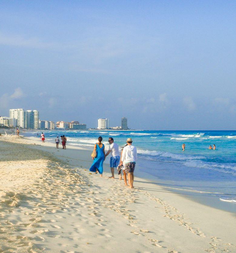 tourist on beach in cancun