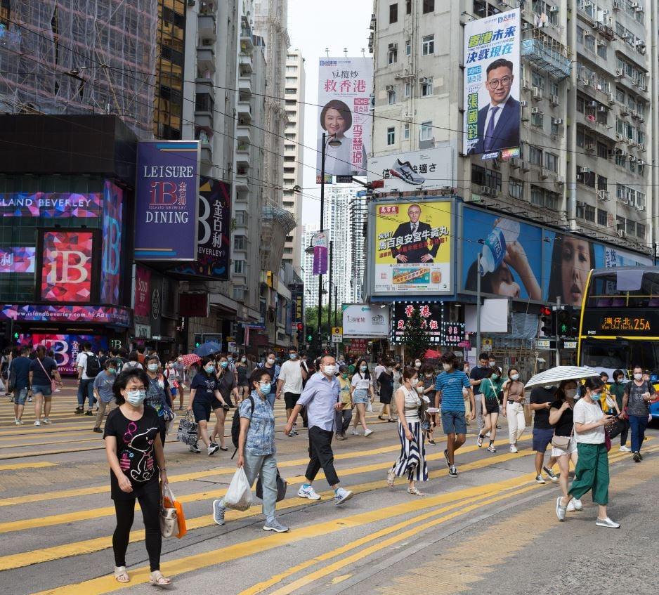 shopping street hong kong travelers wearing maks
