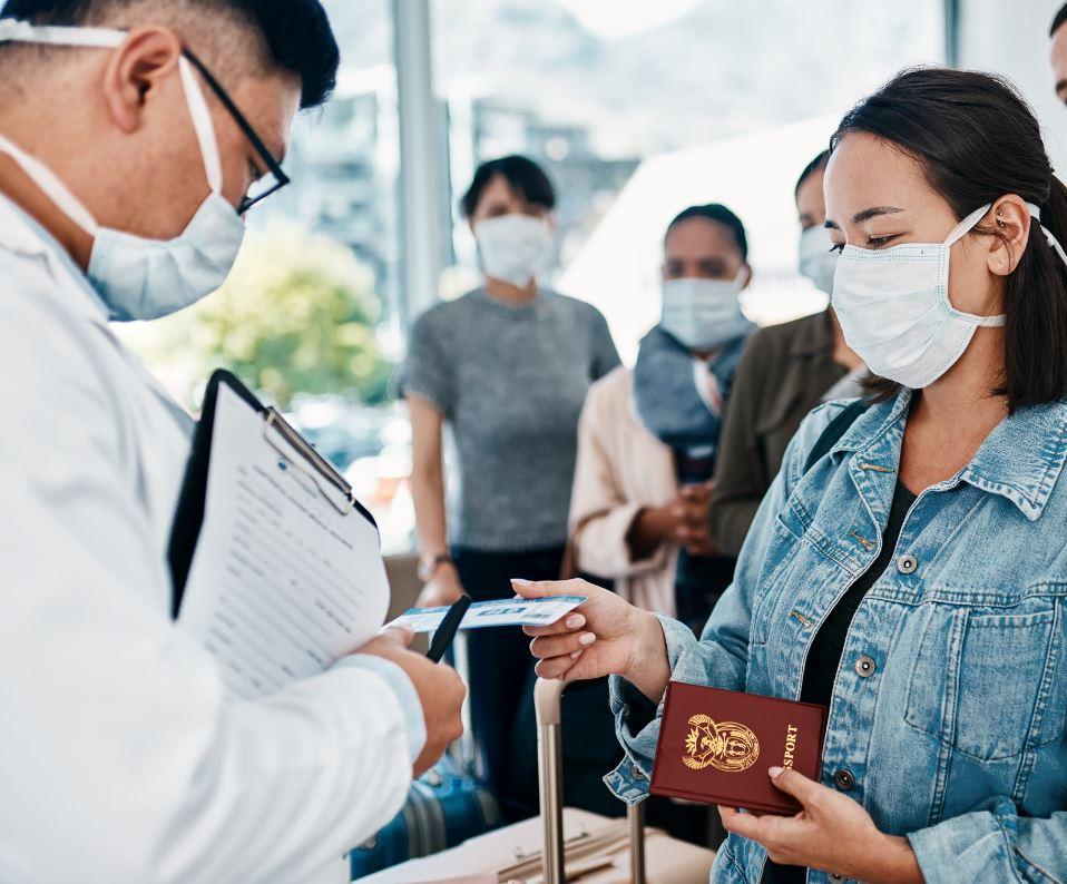 Man checking flight ticket at airport