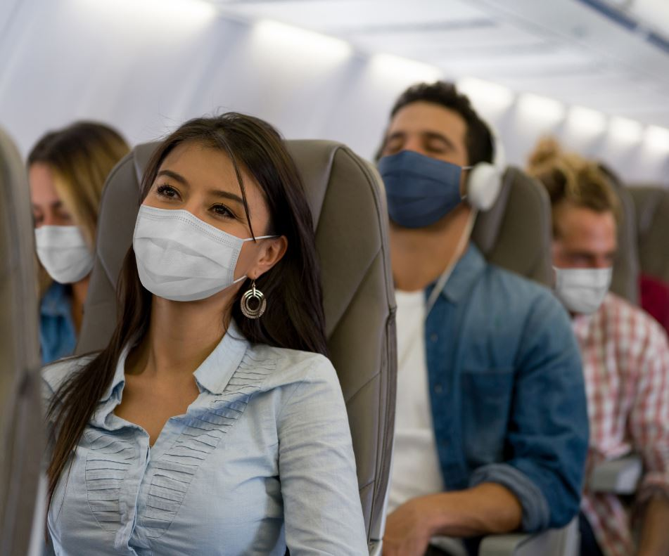 Masked people on plane